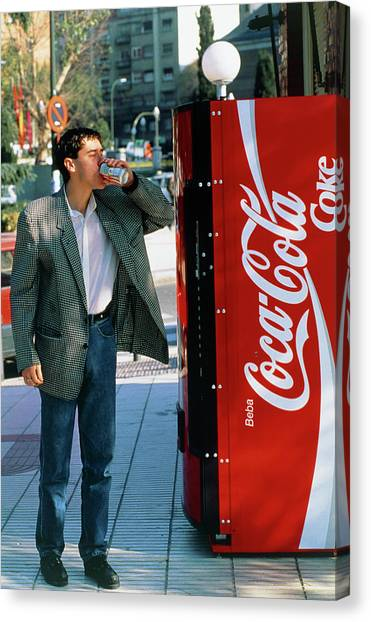 Man Drinking A Can Of Coke Canvas Print by Marcelo Brodsky/science Photo Library