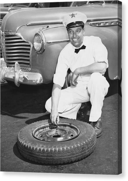Attendant Canvas Print - Man Fixing A Flat Tire by Underwood Archives