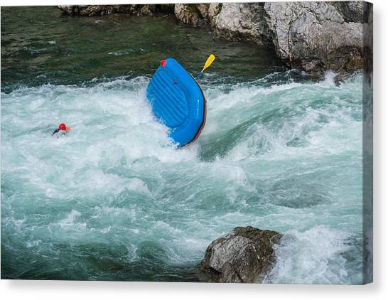 Man Floating In A River After His Raft Flipped Over While White Water River Rafting Canvas Print by Tdub303