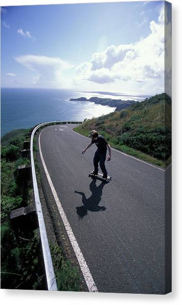 Skateboarding Canvas Print - Man Freebording Skateboarding by Corey Rich