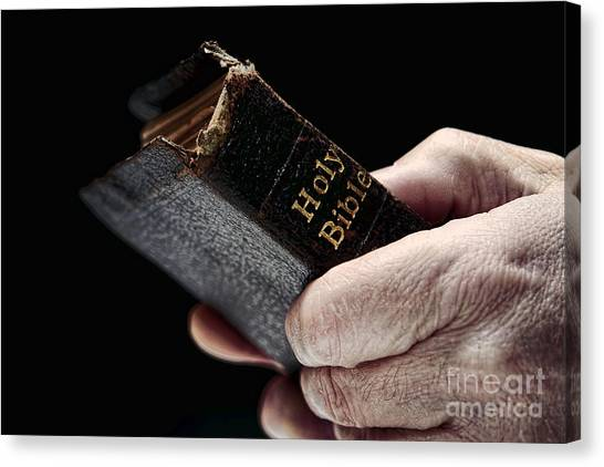 Holy Bible Canvas Print - Man Hands Holding Old Bible by Olivier Le Queinec