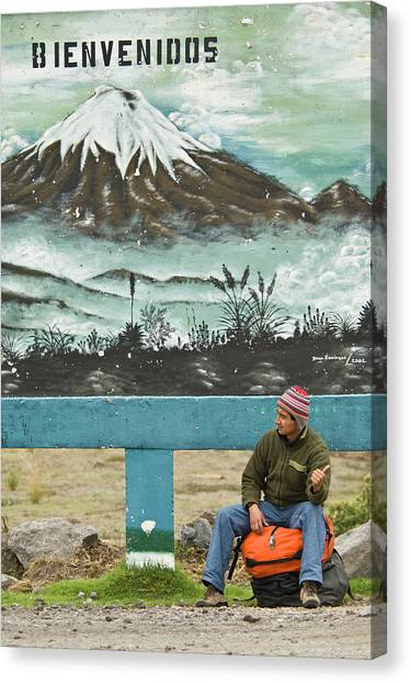 Cotopaxi Canvas Print - Man Hitchhiking Under A Sign That Says by Heath Korvola