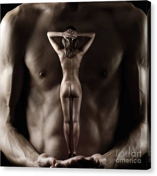 Man Holding A Naked Fitness Woman In His Hands Canvas Print