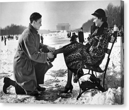 Lincoln Memorial Canvas Print - Man Lends A Helping Hand To Put On Skates by Underwood Archives