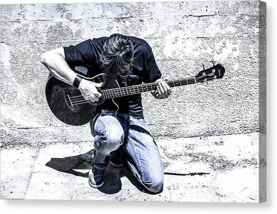 Man Playing Acoustic Guitar Kneeling Outside Canvas Print