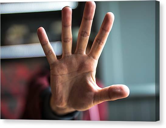Man Showing Stop Gesture Canvas Print by Erik Witsoe / EyeEm