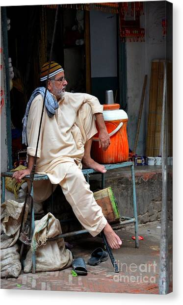 Man Sits And Relaxes In Lahore Walled City Pakistan Canvas Print