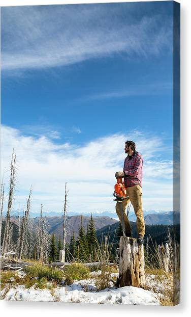 Flannel Canvas Print - Man Standing With Chainsaw On Tree by Craig Moore