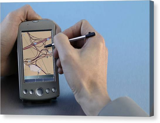 Man Using Gps System Canvas Print by Comstock