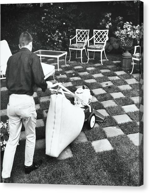 Man Using Lawn Vacuum Canvas Print