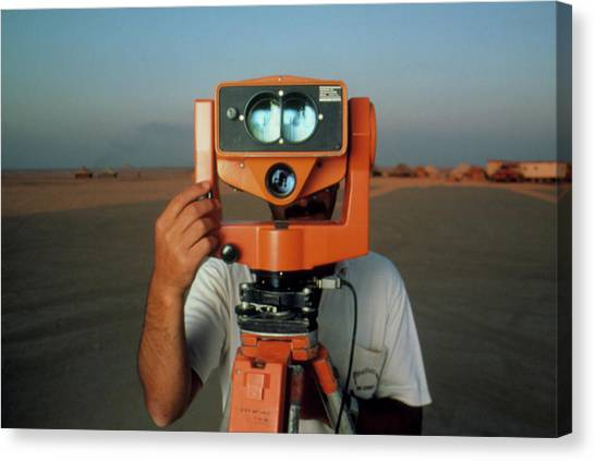 Man With A Survey Instrument In The Libyan Dessert Canvas Print by Joe Pasieka/science Photo Library
