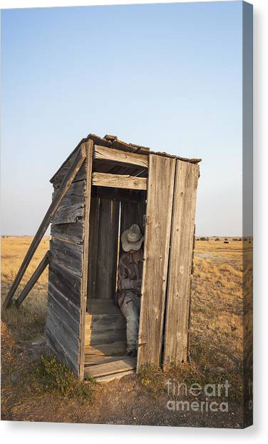 Mannequin Sitting In Old Wooden Outhouse Canvas Print