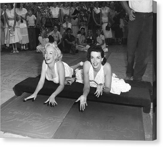 Marilyn Monroe Canvas Print - Marilyn Monroe And Jane Russell by Underwood Archives