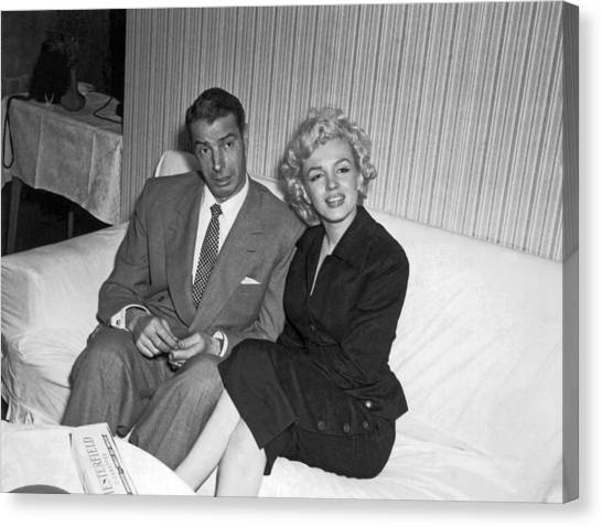 Baseball Players Canvas Print - Marilyn Monroe And Joe Dimaggio by Underwood Archives