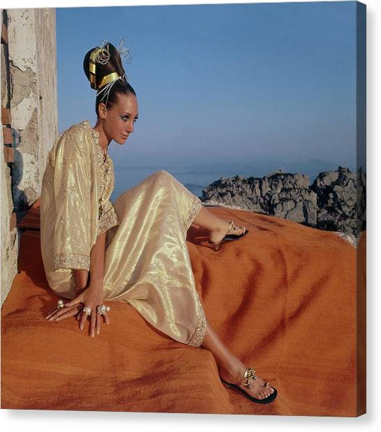 Updo Canvas Print - Marisa Berenson Wearing A Gold Caftan By Tina by Henry Clarke
