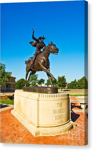 Canvas Print featuring the photograph Masked Rider Statue by Mae Wertz