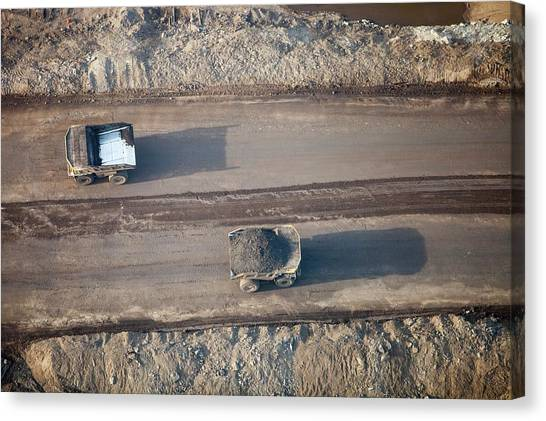 Dump Trucks Canvas Print - Massive Dump Trucks Loaded With Tar Sand by Ashley Cooper
