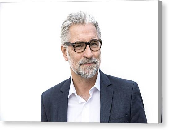Mature Grey-haired Man In Suit Smiling Canvas Print by Robin Skjoldborg