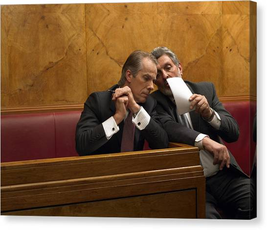 Mature Man Whispering To Colleague In Pew Canvas Print by Michael Blann
