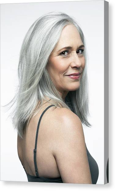 Mature Woman With Grey Hair In A 3/4 Position. Canvas Print by Andreas Kuehn