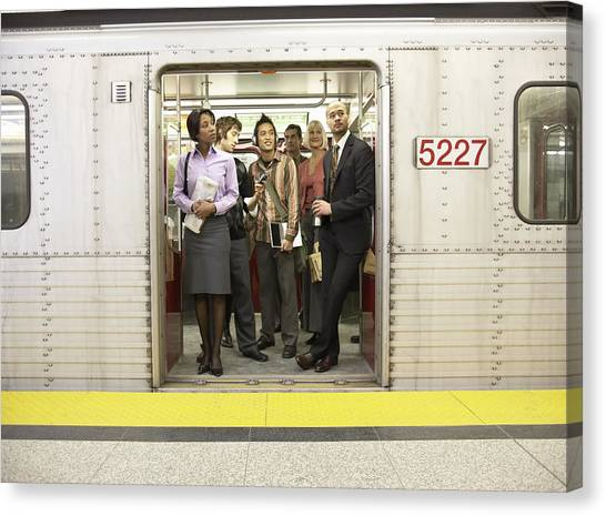 Medium Group Of People Standing In Subway Train Doorway Canvas Print by Darrin Klimek
