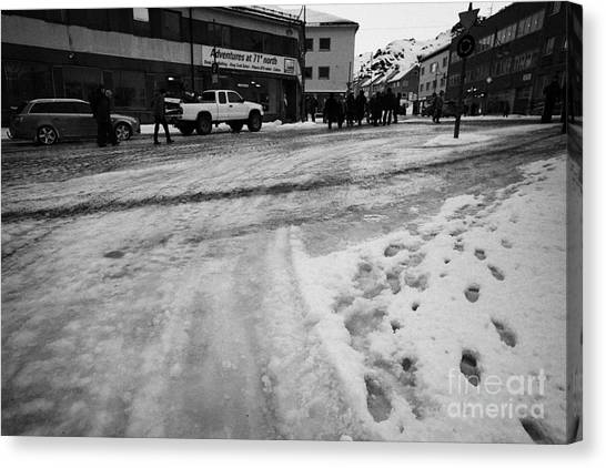 melting ice and snow on street surface holmen Honningsvag finnmark norway europe Canvas Print by Joe Fox