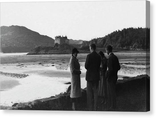 Men And Women Standing On A Bank Of A Lake Canvas Print