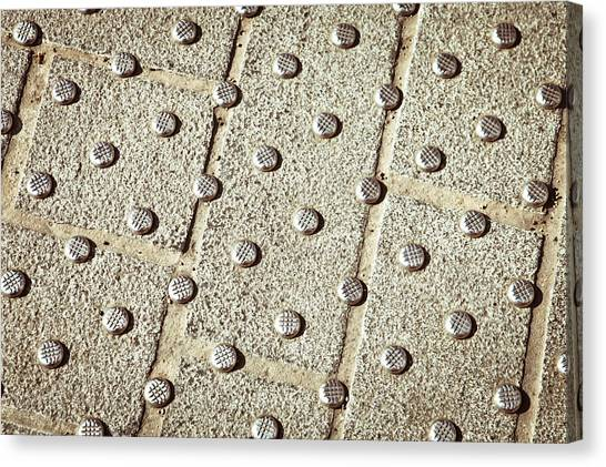 Brick Sidewalk Canvas Print - Metal Studs by Tom Gowanlock