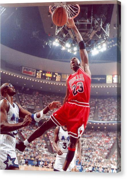 Three Pointer Canvas Print - Michael Jordan Dunks With Left Hand by Retro Images Archive