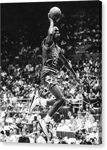 Slam Dunk Canvas Print - Michael Jordan Gliding by Retro Images Archive