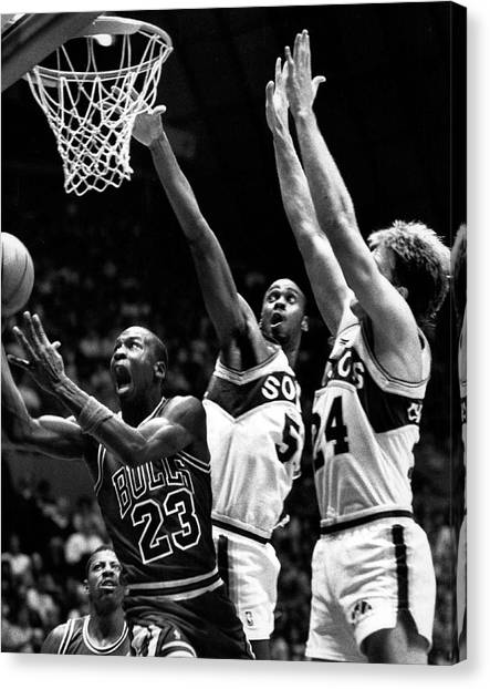 Three Pointer Canvas Print - Michael Jordan Going For A Hard Layup by Retro Images Archive