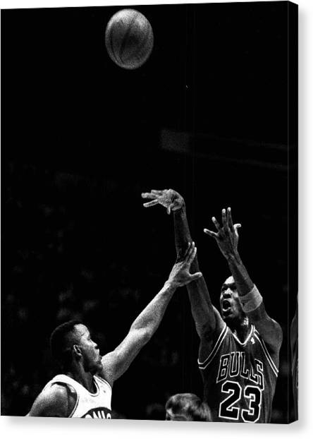 Three Pointer Canvas Print - Michael Jordan Shooting Over Another Player by Retro Images Archive