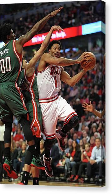 Milwaukee Bucks V Chicago Bulls - Game Canvas Print by Jonathan Daniel