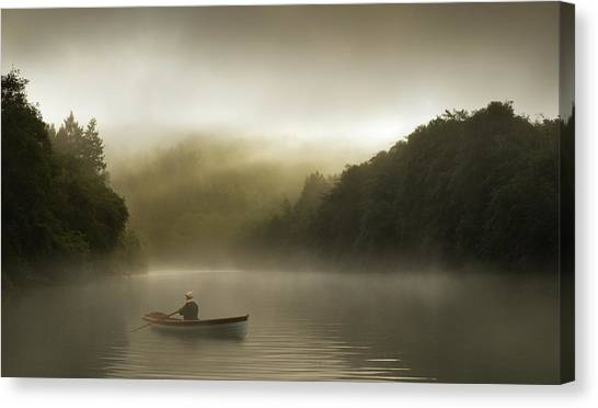 Misty Morning Row On A Forested River Canvas Print by Justin Lewis
