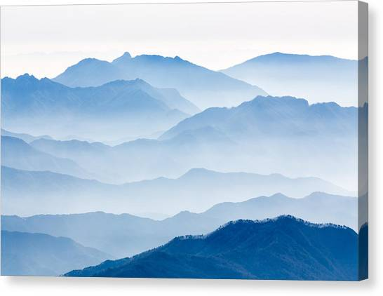Mountain Ranges Canvas Print - Misty Mountains by Gwangseop Eom