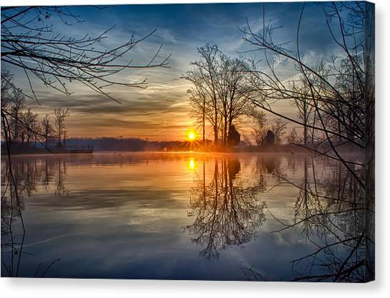 Misty Sunrise Canvas Print by Dan Holland