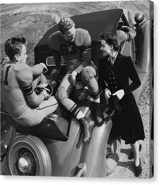 Model By Football Players On A Car Canvas Print