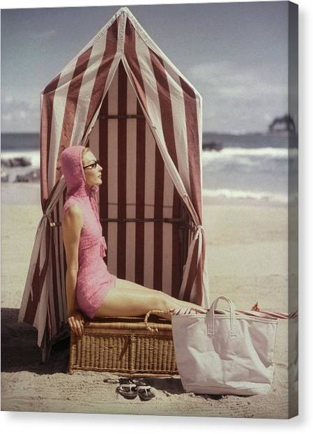 Model In Pink Swimsuit With Tent On Beach Canvas Print by Louise Dahl-Wolfe