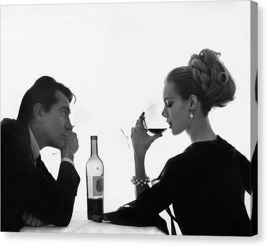 Man Gazing At Woman Sipping Wine Canvas Print by Bert Stern