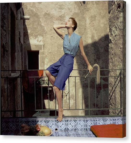Model Wearing Blue Culottes And A Sea-green Shirt Canvas Print by Henry Clarke