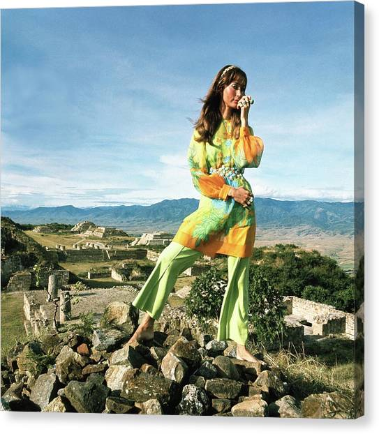 Oaxaca Canvas Print - Model Wearing Floral Print Tunic Over A Green by Henry Clarke