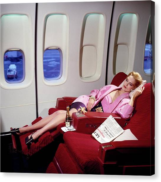 Model Wearing Pink Jacket On Airplane Canvas Print