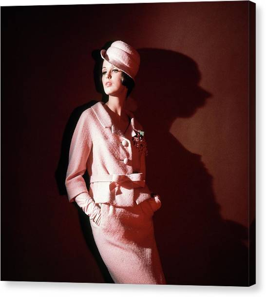 1ca89135287f83 Cloche Canvas Print - Model Wearing Pink Suit And Hat by Horst P. Horst