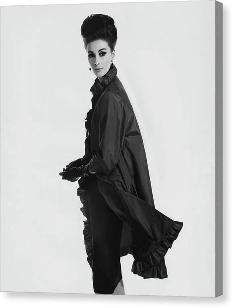 Adele Canvas Print - Model Wearing Ruffled Raincoat by Karen Radkai