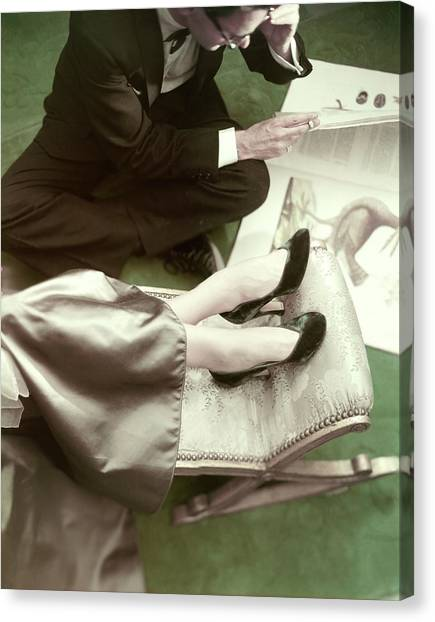 Model Wearing Velvet Pumps With A Man Sitting Canvas Print by Frances McLaughlin-Gill