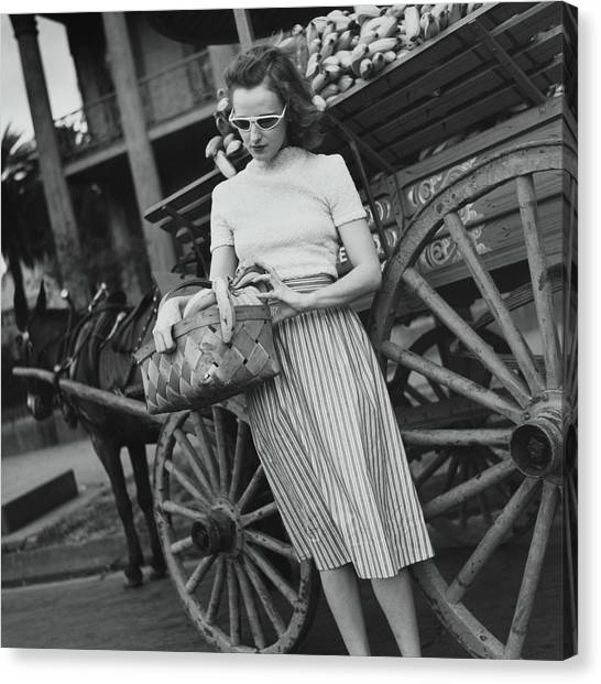 Model With Basket Of Bananas Canvas Print