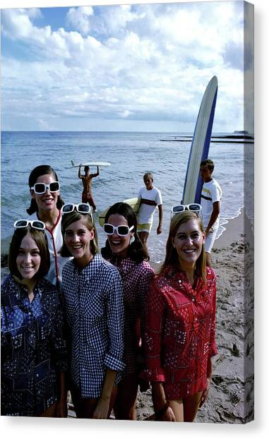 Models And Surfers On A Beach Canvas Print