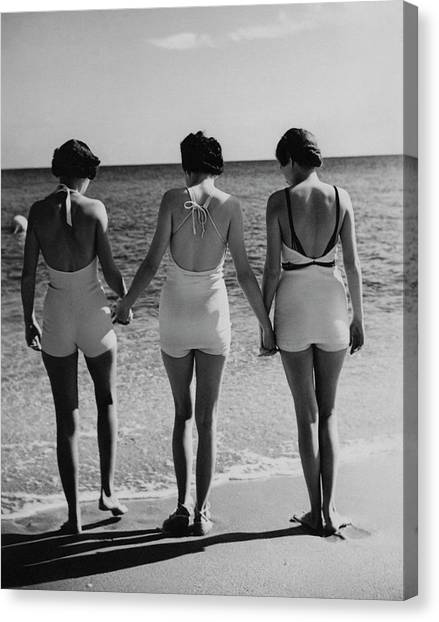 Models On A Beach Canvas Print by Toni Frissell