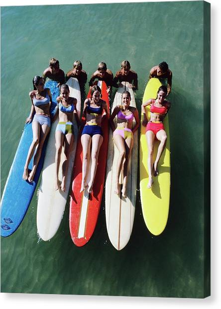 Models Wearing Bikinis Lying On Surfboards Canvas Print by William Connors