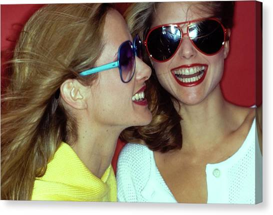 Models Wearing Sunglasses Canvas Print by Jacques Malignon